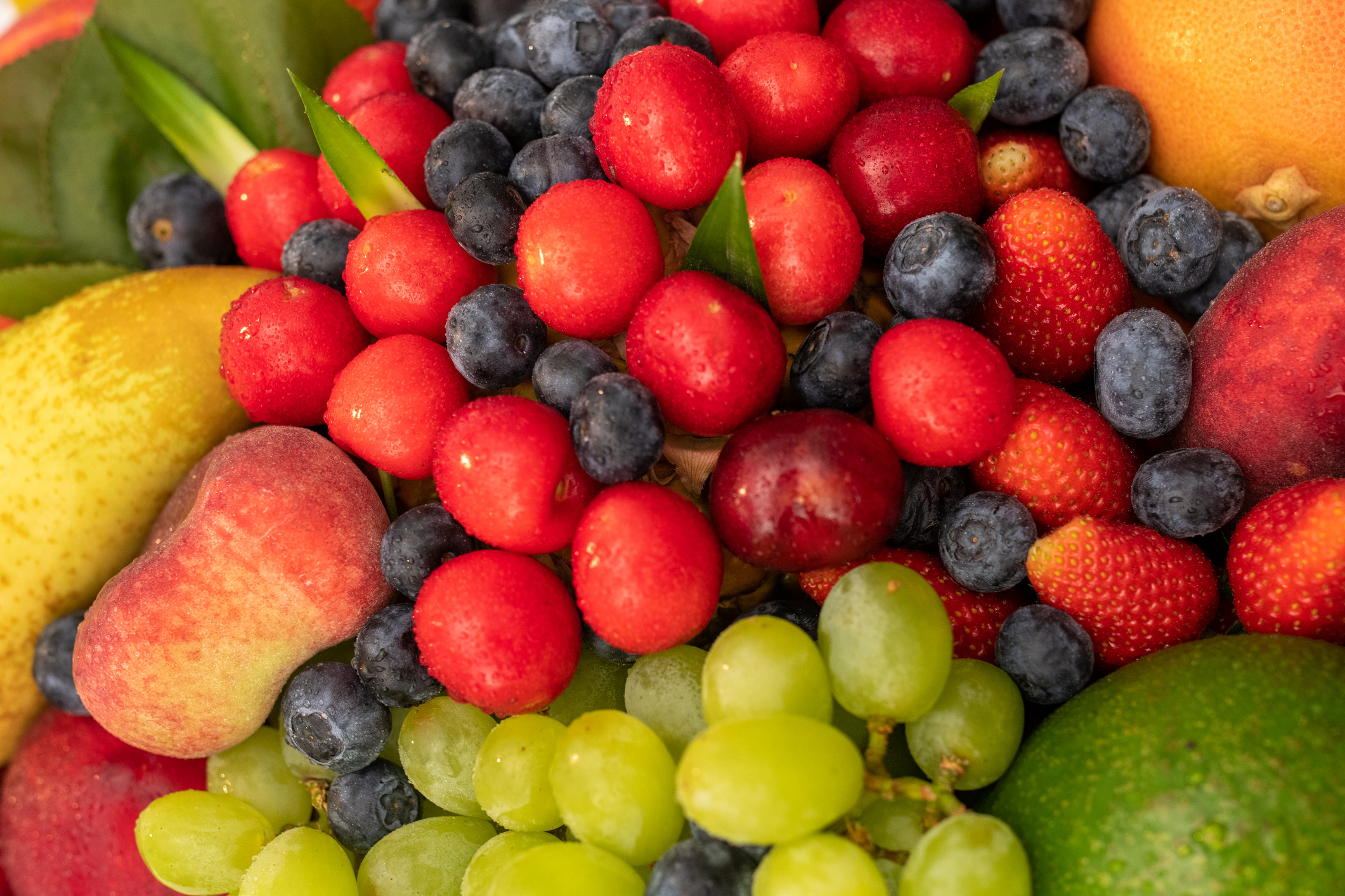 Macro view of different kind of ripe, fresh, colourful fruit, full frame.